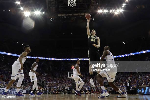 Isaac Haas of the Purdue Boilermakers attempts a shot against the Kansas Jayhawks during the 2017 NCAA Men's Basketball Tournament Midwest Regional...