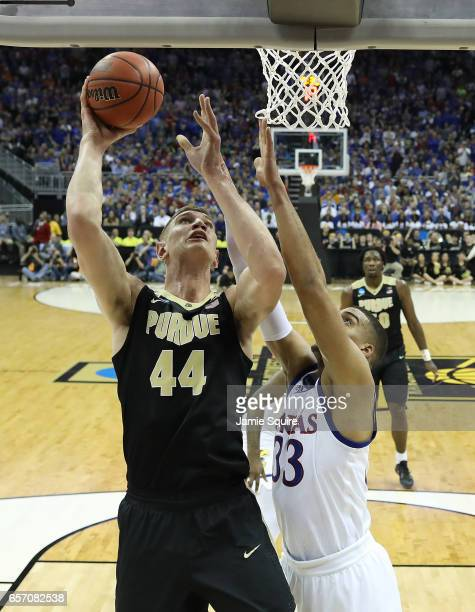Isaac Haas of the Purdue Boilermakers attempts a shot defended by Landen Lucas of the Kansas Jayhawks during the 2017 NCAA Men's Basketball...