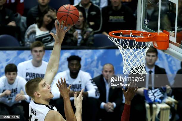 Isaac Haas of the Purdue Boilermakers attempts a shot in the second half against the Iowa State Cyclones during the second round of the 2017 NCAA...