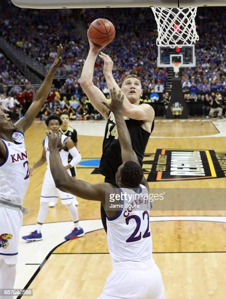 Isaac Haas of the Purdue Boilermakers attempts a shot over Dwight Coleby of the Kansas Jayhawks during the 2017 NCAA Men's Basketball Tournament...