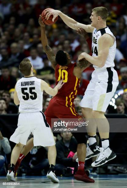 Isaac Haas of the Purdue Boilermakers blocks a shot attempt by Darrell Bowie of the Iowa State Cyclones in the first half during the second round of...