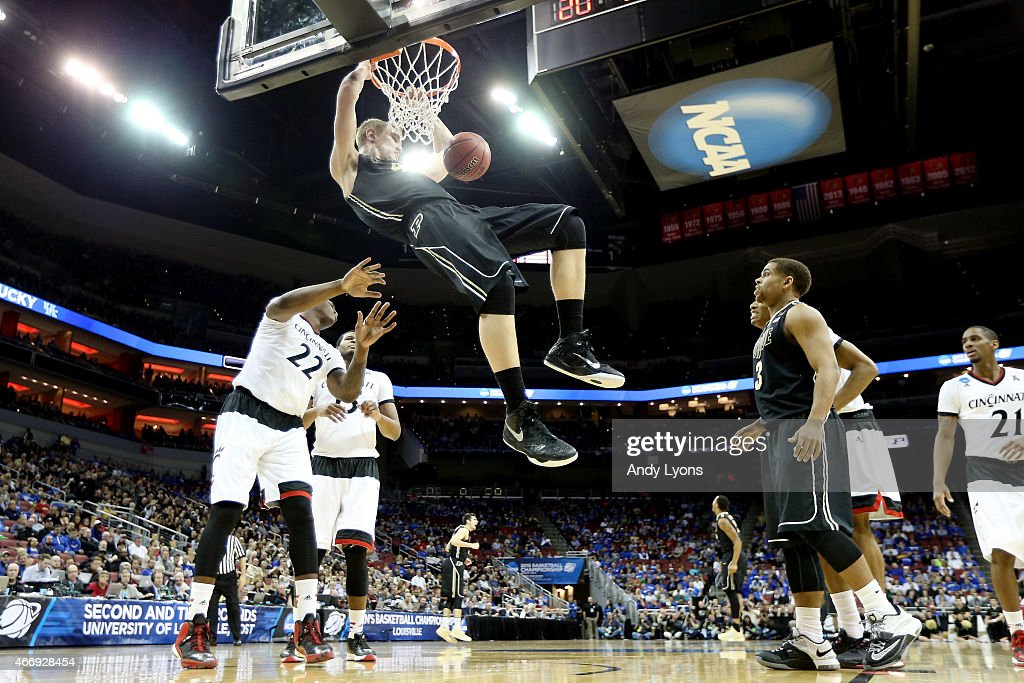 Isaac Haas #44 of the Purdue Boilermakers dunks against the Cincinnati Bearcats during the second round of the 2015 NCAA Men's Basketball Tournament at the KFC YUM! Center on March 19, 2015 in Louisville, Kentucky.