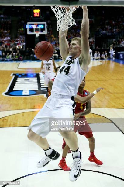 Isaac Haas of the Purdue Boilermakers dunks the ball in the first half against the Iowa State Cyclones during the second round of the 2017 NCAA...