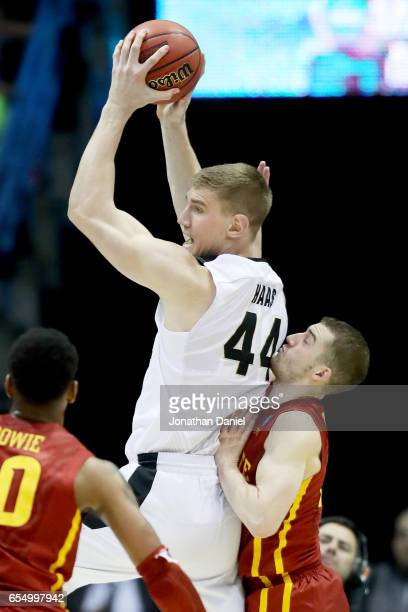 Isaac Haas of the Purdue Boilermakers grabs a rebound in front of Matt Thomas of the Iowa State Cyclones in the second half during the second round...