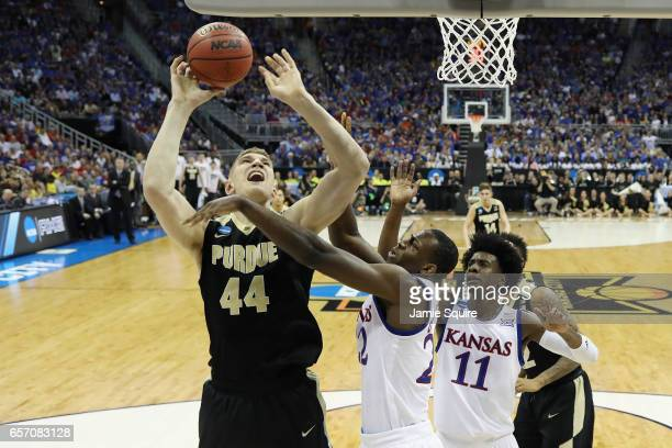 Isaac Haas of the Purdue Boilermakers handles the ball against Dwight Coleby of the Kansas Jayhawks in the first half during the 2017 NCAA Men's...