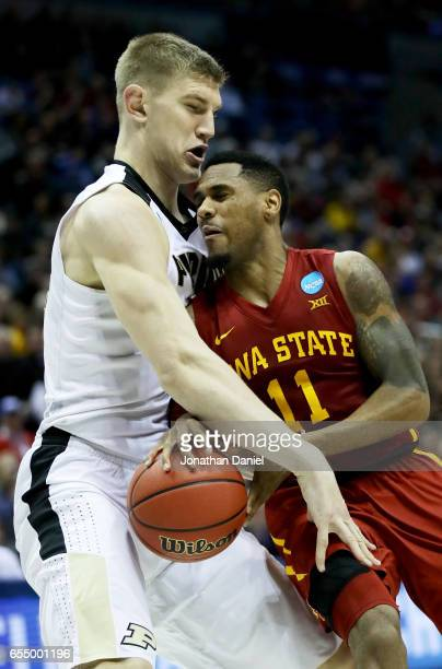 Isaac Haas of the Purdue Boilermakers knocks the ball away from Monte Morris of the Iowa State Cyclones in the second half during the second round of...
