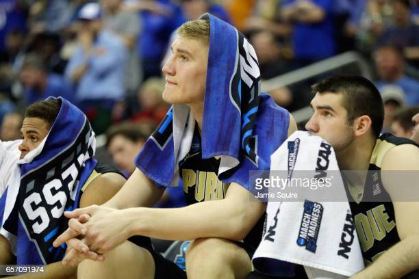 Isaac Haas of the Purdue Boilermakers reacts with teammates on the bench in the second half against the Kansas Jayhawks during the 2017 NCAA Men's...