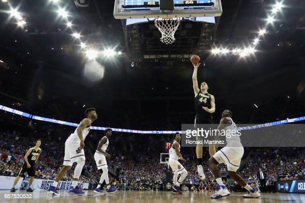 Isaac Haas of the Purdue Boilermakers shoots the ball against the Kansas Jayhawks during the 2017 NCAA Men's Basketball Tournament Midwest Regional...