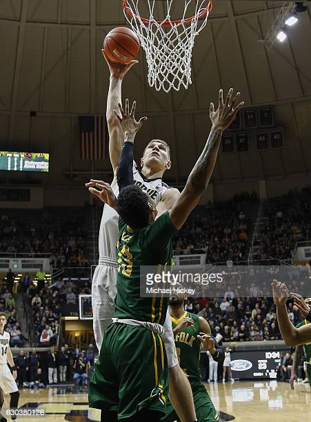 Isaac Haas of the Purdue Boilermakers shoots the ball over Stavian Allen of the Norfolk State Spartans at Mackey Arena on December 21 2016 in West...
