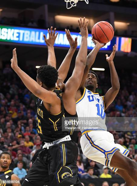 Isaac Hamilton of the UCLA Bruins attempts a shot against the Kent State Golden Flashes during the first round of the 2017 NCAA Men's Basketball...