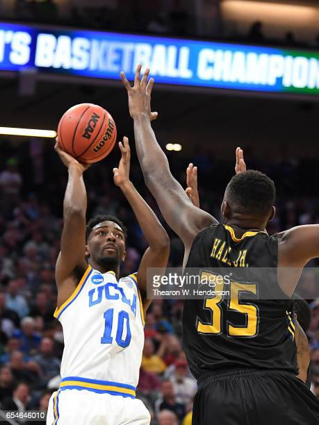 Isaac Hamilton of the UCLA Bruins attempts a shot defended by Jimmy Hall of the Kent State Golden Flashes during the first round of the 2017 NCAA...