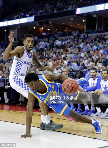 Isaac Hamilton of the UCLA Bruins loses his footing against Malik Monk of the Kentucky Wildcats in the first half during the 2017 NCAA Men's...