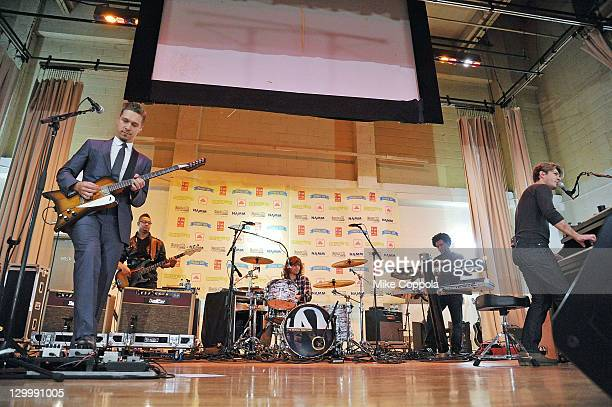 Isaac Hanson Zac Hanson and Taylor Hanson of the band Hanson perform at the VH1 Save the Music Foundation Family Day at the The Anderson School on...