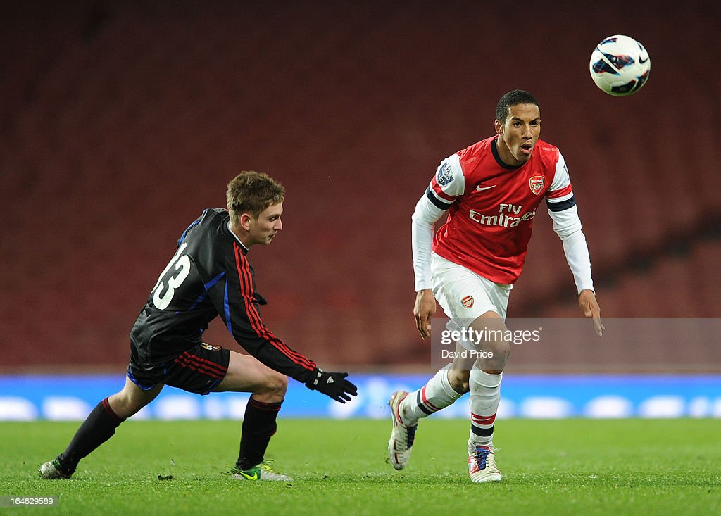Isaac Hayden of Arsenal takes on Svyatoslav Georgievsky of CSKA during the NextGen Series Quarter Final match between Arsenal and PFC CSKA at Emirates Stadium on March 25, 2013 in London, England.