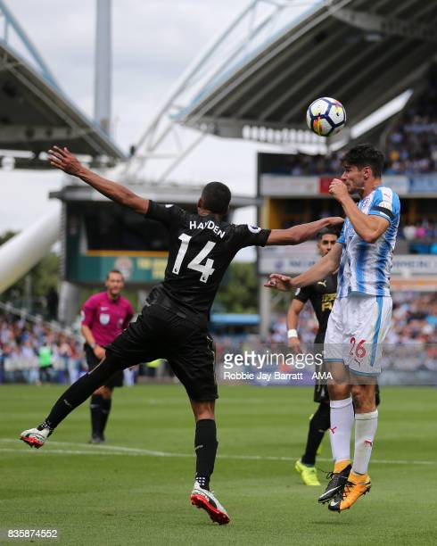 Isaac Hayden of Newcastle United and Christopher Schindler of Huddersfield Town during the Premier League match between Huddersfield Town and...