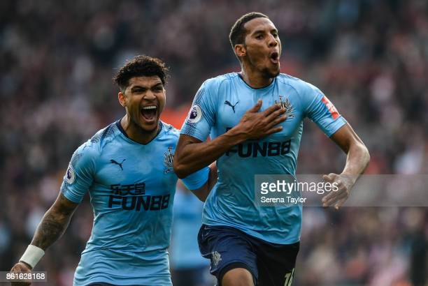 Isaac Hayden of Newcastle United celebrates after scoring the opening goal with teammate DeAndre Yedlin during the Premier League match between...