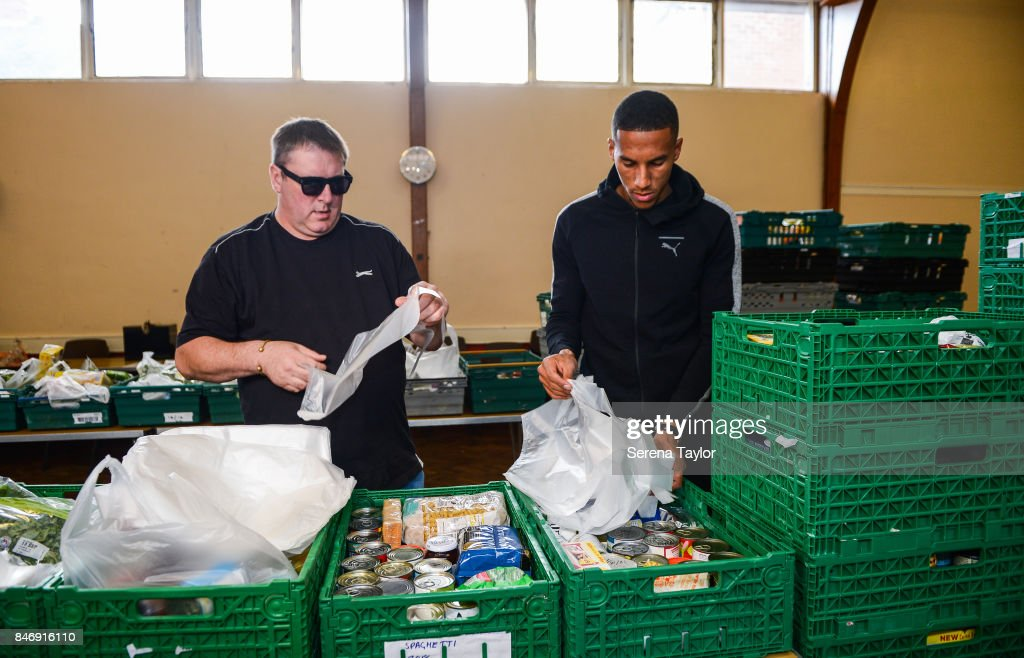 Isaac Hayden of Newcastle United packs food packs during a visit to Newcastle West End Foodbank on September 14, 2017, in Newcastle upon Tyne, England.