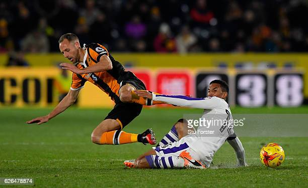 Isaac Hayden of Newcastle United tackles David Meyler of Hull City during the EFL Cup QuarterFinal match between Hull City and Newcastle United at...