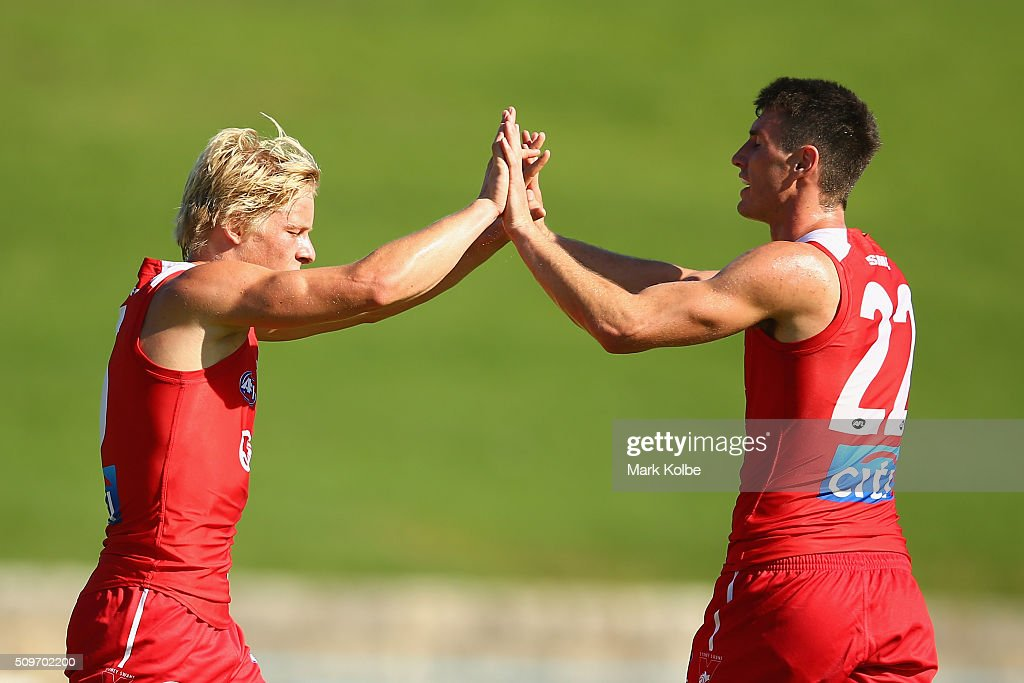Isaac Heeney and Dean Towers of the Red Team celebrate a goal during the Sydney Swans AFL intra-club match at Henson Park on February 12, 2016 in Sydney, Australia.