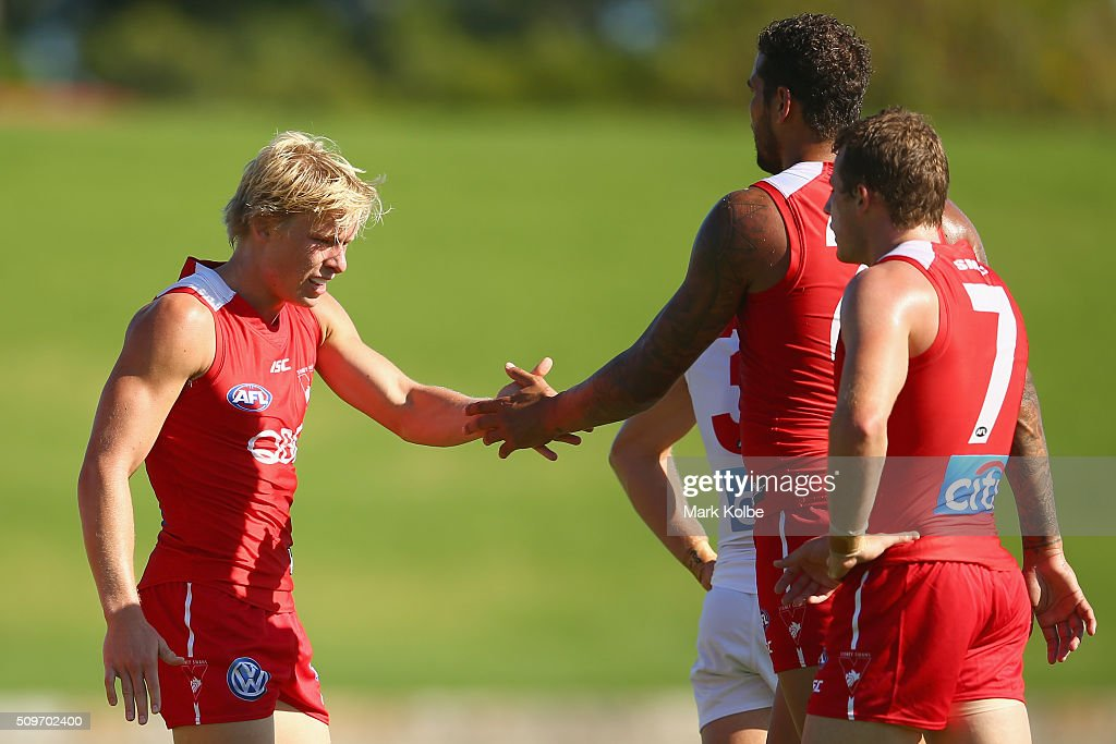 Isaac Heeney and <a gi-track='captionPersonalityLinkClicked' href=/galleries/search?phrase=Lance+Franklin&family=editorial&specificpeople=561332 ng-click='$event.stopPropagation()'>Lance Franklin</a> of the Red Team celebrate a goal during the Sydney Swans AFL intra-club match at Henson Park on February 12, 2016 in Sydney, Australia.