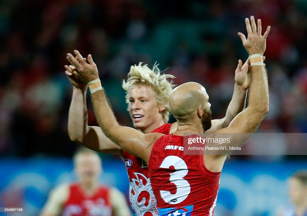 Isaac Heeney celebrates with <a gi-track='captionPersonalityLinkClicked' href=/galleries/search?phrase=Jarrad+McVeigh&family=editorial&specificpeople=3083250 ng-click='$event.stopPropagation()'>Jarrad McVeigh</a> of the Swans during the 2016 AFL Round 10 match between the Sydney Swans and the North Melbourne Kangaroos at the Sydney Cricket Ground on May 27, 2016 in Sydney, Australia.