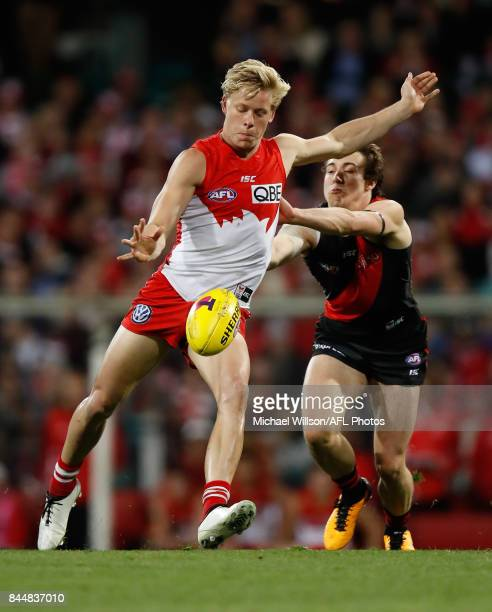Isaac Heeney of the Swans and Andrew McGrath of the Bombers compete for the ball during the AFL Second Elimination Final match between the Sydney...