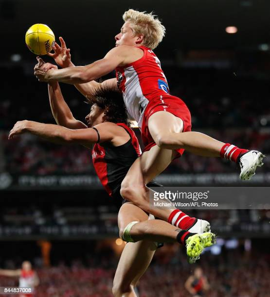 Isaac Heeney of the Swans and Mark Baguley of the Bombers compete for the ball during the AFL Second Elimination Final match between the Sydney Swans...