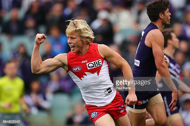 Isaac Heeney of the Swans celebrates a goal during the round 19 AFL match between the Fremantle Dockers and the Sydney Swans at Domain Stadium on...