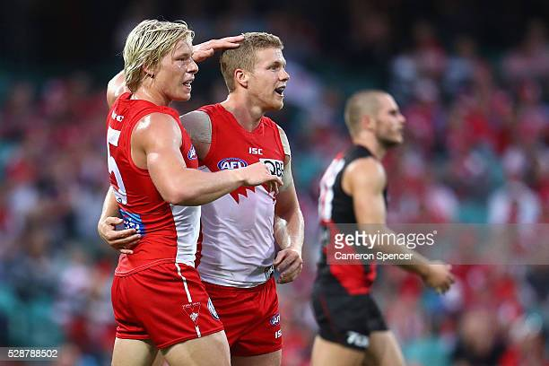 Isaac Heeney of the Swans celebrates kicking a goal with team mate Dan Hannebery during the round seven AFL match between the Sydney Swans and the...