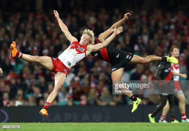 Isaac Heeney of the Swans clashes with Mark Baguley of the Bombers during the round 14 AFL match between the Sydney Swans and the Essendon Bombers at...