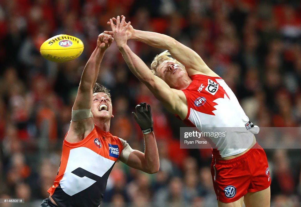 Isaac Heeney of the Swans competes for the ball against Aidan Corr of the Giants during the round 17 AFL match between the Greater Western Sydney Giants and the Sydney Swans at Spotless Stadium on July 15, 2017 in Sydney, Australia.