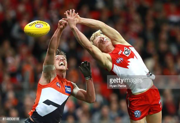 Isaac Heeney of the Swans competes for the ball against Aidan Corr of the Giants during the round 17 AFL match between the Greater Western Sydney...