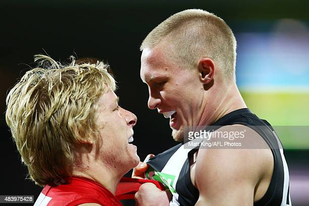 Isaac Heeney of the Swans faces off against Jack Frost of the Magpies during the round 20 AFL match between the Sydney Swans and the Collingwood...