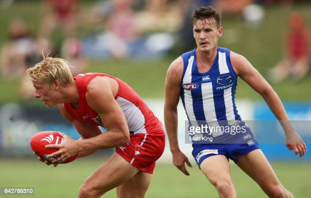 Isaac Heeney of the Swans handles the ball during the 2017 JLT Community Series match between the Sydney Swans and North Melbourne Kangaroos at Coffs...