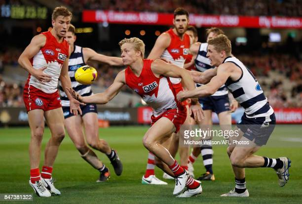 Isaac Heeney of the Swans is tackled by Scott Selwood of the Cats during the 2017 AFL Second Semi Final match between the Geelong Cats and the Sydney...