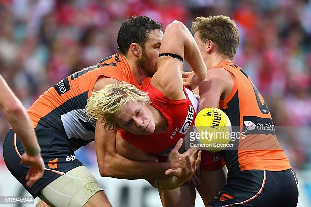 Isaac Heeney of the Swans is tackled during the round three AFL match between the Sydney Swans and the Greater Western Sydney Giants at Sydney...