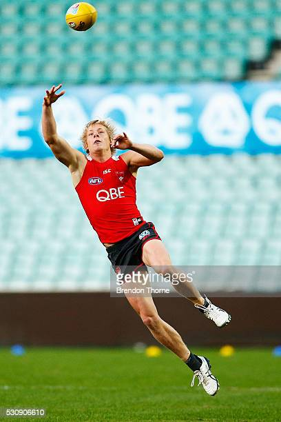 Isaac Heeney of the Swans jumps to grab the ball during a Sydney Swans media and training session at Sydney Cricket Ground on May 12 2016 in Sydney...