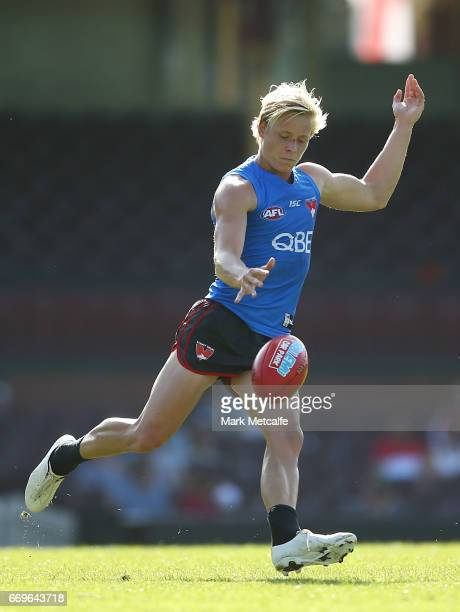 Isaac Heeney of the Swans kicks during a Sydney Swans AFL Training Session at Sydney Cricket Ground on April 18 2017 in Sydney Australia