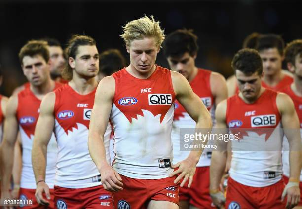 Isaac Heeney of the Swans looks dejected after losing the round 19 AFL match between the Hawthorn Hawks and the Sydney Swans at Melbourne Cricket...