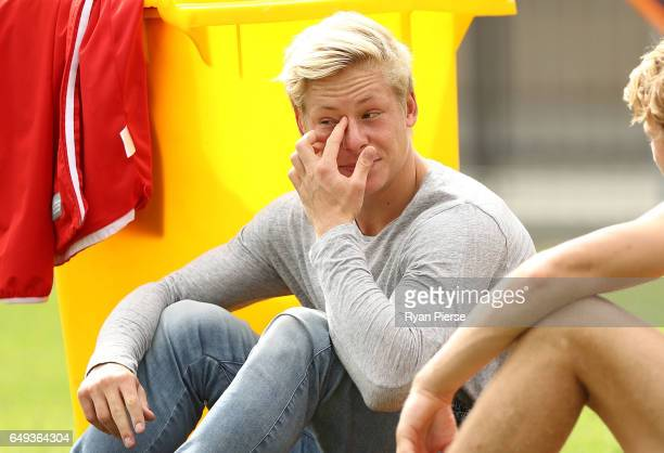 Isaac Heeney of the Swans looks from the sidelines during a Sydney Swans AFL training session at Lakeside Oval on March 8 2017 in Sydney Australia