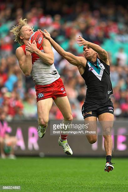 Isaac Heeney of the Swans takes a mark during the round 20 AFL match between the Sydney Swans and the Port Adelaide Power at Sydney Cricket Ground on...