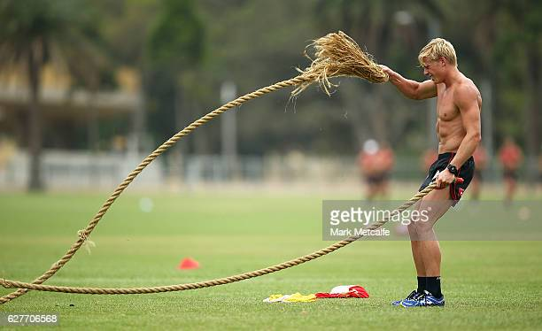 Isaac Heeney performs strength drills during a Sydney Swans AFL preseason training session at Lakeside Oval on December 5 2016 in Sydney Australia