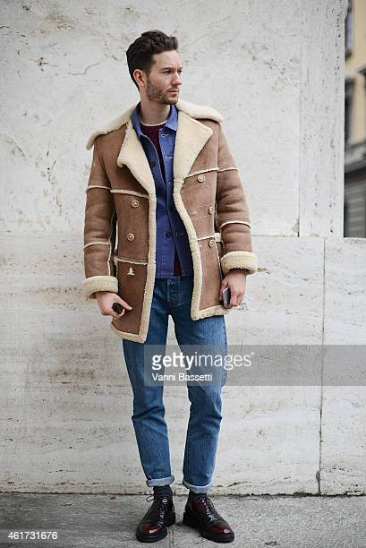Isaac HirdinMiller poses wearing a vintage coat and Levi's pants during day 2 of Milan Menswear Fashion Week Fall/Winter 2015/2016 on January 18 2015...