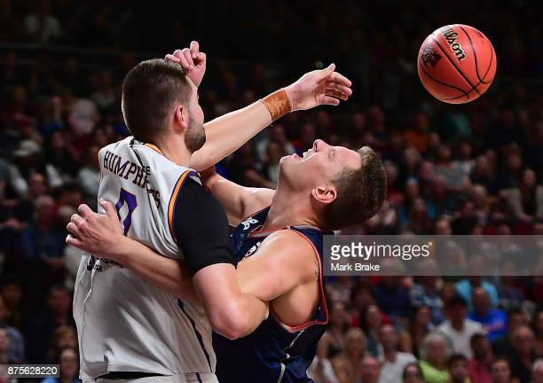 Isaac Humphries of the Sydney Kings crashes into Daniel Johnson of the 36ers during the round seven NBL match between Adelaide 36ers and the Sydney...