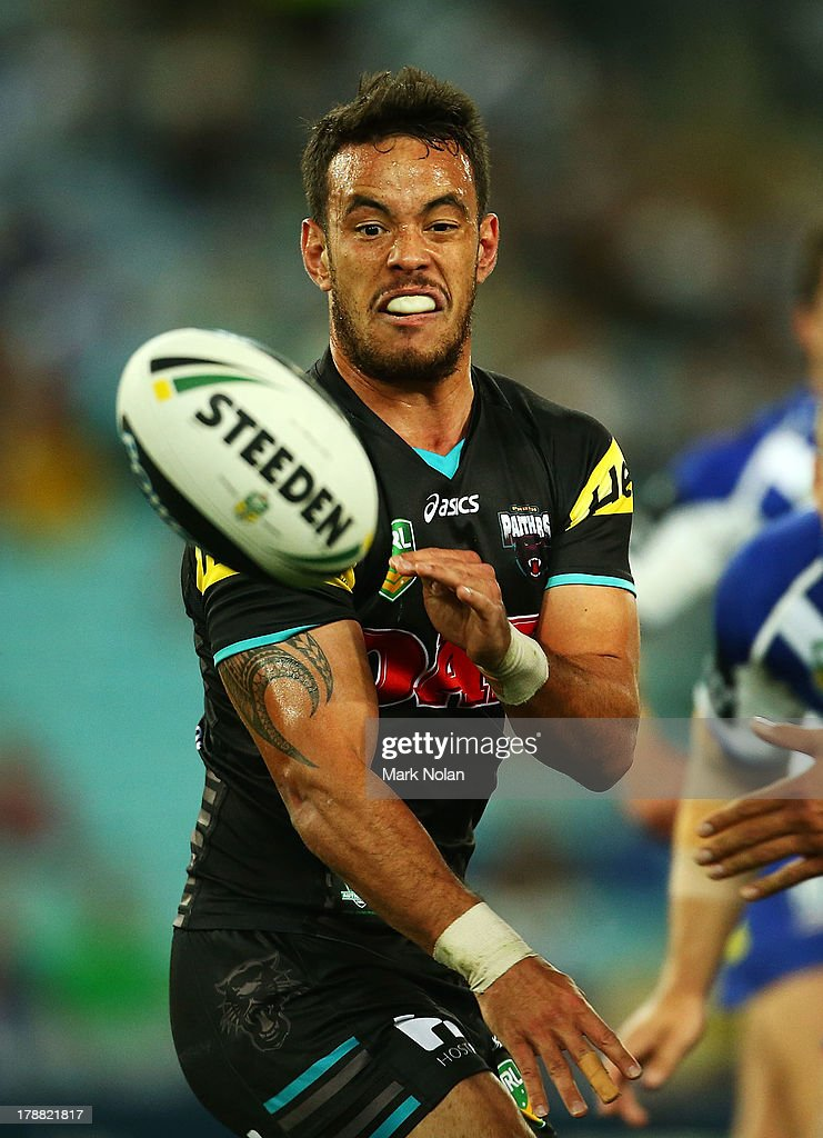 Isaac John of the Panthers passes during the round 25 NRL match between the Canterbury Bulldogs and the Penrith Panthers at ANZ Stadium on August 31, 2013 in Sydney, Australia.