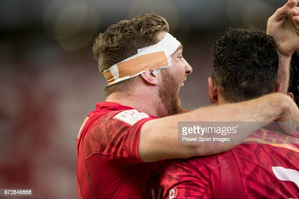 Isaac Kaay of Canada celebrates winning the game with teammates at the conclusion of the match Canada vs England Day 2 of the HSBC Singapore Rugby...