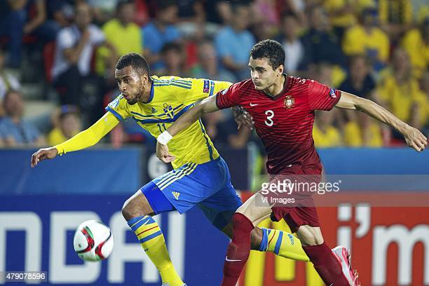 Isaac Kiese Thelin of Sweden Tiago Ilori of Portugal during the UEFA European Under21 Championship final match between Sweden and Portugal on June 30...