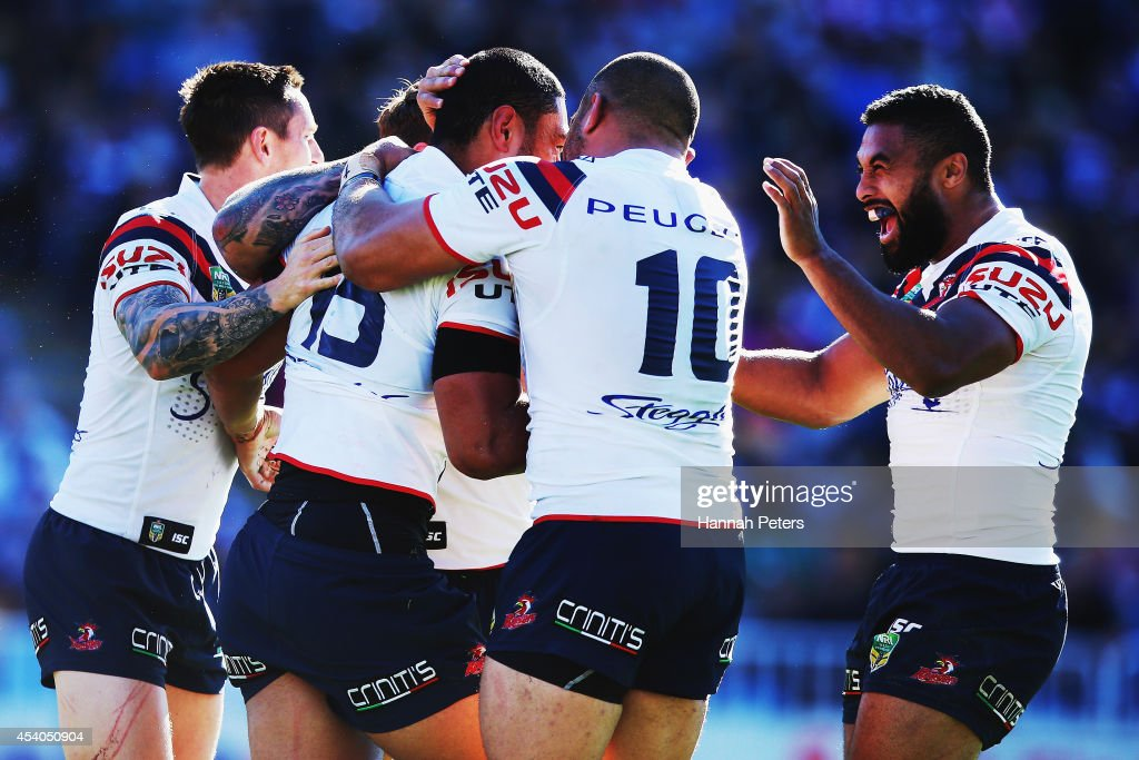 Isaac Liu of the Roosters celebrates with his team after scoring a try during the round 24 NRL match between the New Zealand Warriors and the Sydney Roosters at Mt Smart Stadium on August 24, 2014 in Auckland, New Zealand.