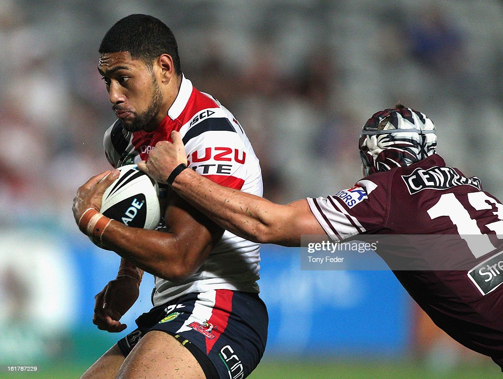Isaac Liu of the Roosters is tackled by Jamie Buhrer of the Sea Eagles during the NRL trial match between the Manly Sea Eagles and the Sydney Roosters at Bluetongue Stadium on February 16, 2013 in Gosford, Australia.