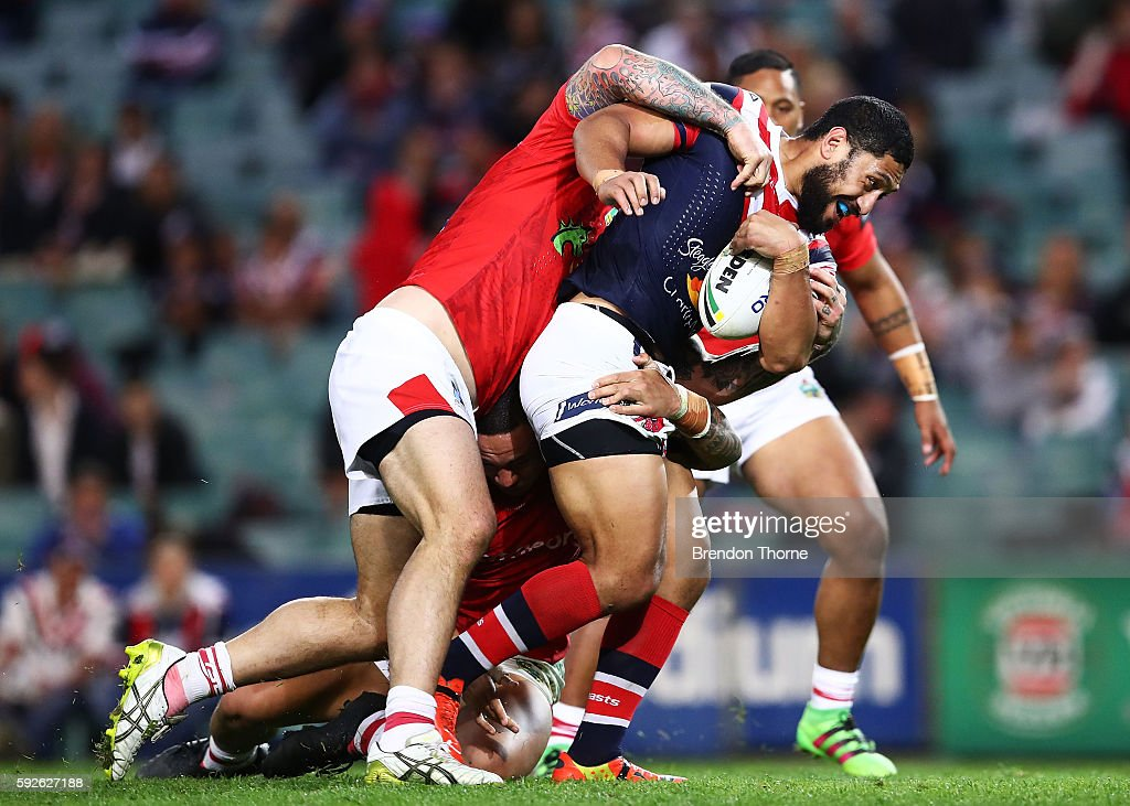 Isaac Liu of the Roosters is tackled by the Dragons defence during the round 24 NRL match between the Sydney Roosters and the St George Illawarra Dragons at Allianz Stadium on August 21, 2016 in Sydney, Australia.